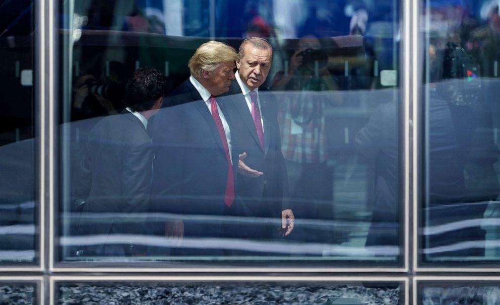 PHOTO: President Donald Trump and Turkeys President Recep Tayyip Erdogan talk during the NATO (North Atlantic Treaty Organization) summit in Brussels, July 11, 2018.