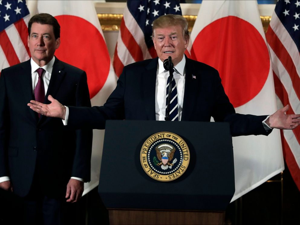 PHOTO: President Donald Trump speaks with Japanese business leaders, Saturday, May 25, 2019, in Tokyo, as U.S. Ambassador to Japan William Hagerty listens.