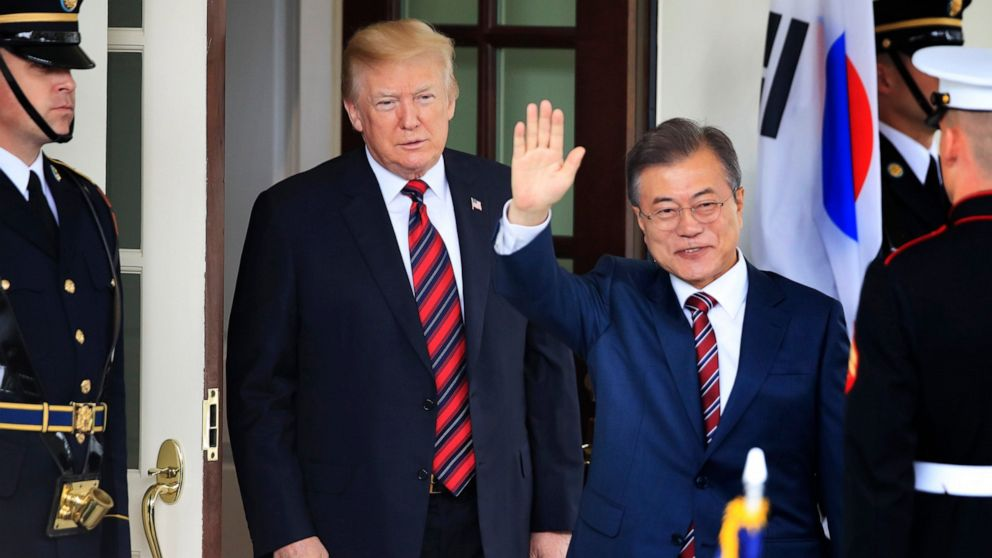 In this May 22, 2018, file photo, South Korean President Moon Jae-in waves as he is welcomed by U.S. President Donald Trump to the White House in Washington.