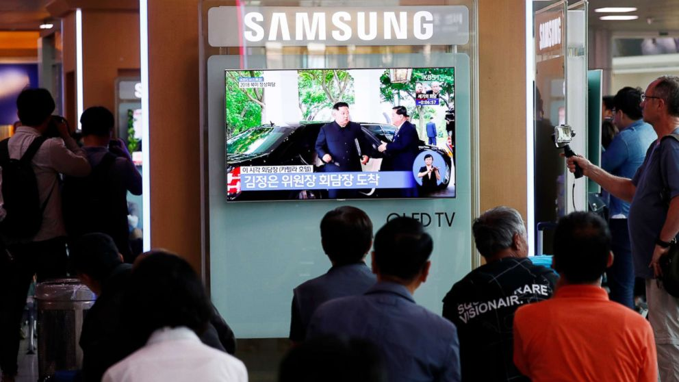 South Koreans watch a TV screen displaying a broadcast of the historic meeting between President Donald J. Trump and North Korean leader Kim Jong-un in Singapore, at a station in Seoul, South Korea, June 12, 2018.