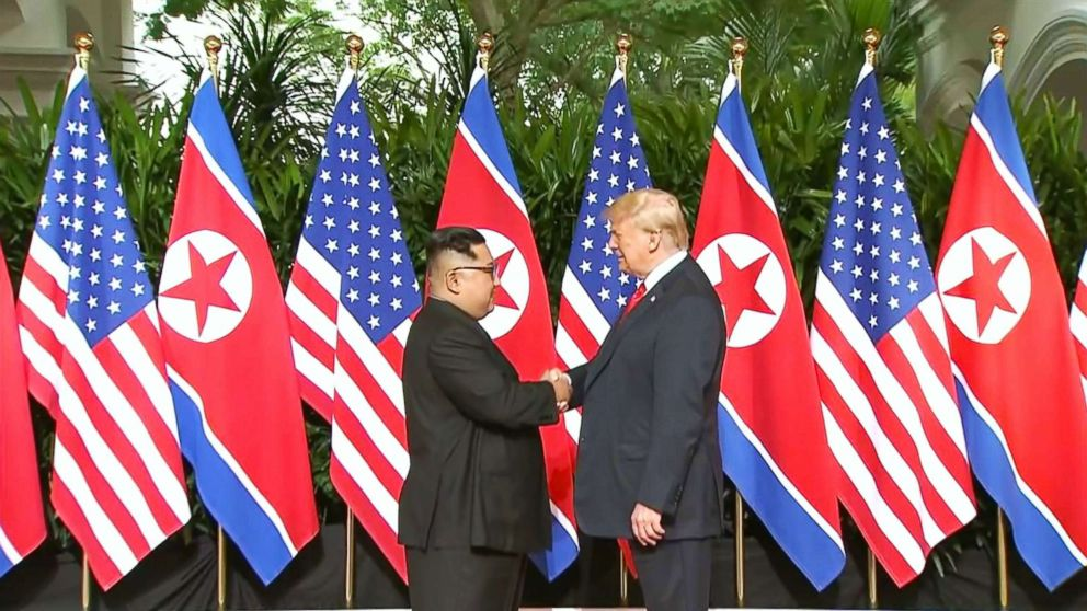 President Donald Trump and North Korean leader Kim Jong Un pose together ahead of their meeting at Capella Hotel in Singapore, on June 12, 2018.