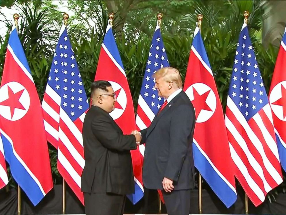 PHOTO: President Donald Trump and North Korean leader Kim Jong Un pose together ahead of their meeting at Capella Hotel in Singapore, on June 12, 2018.