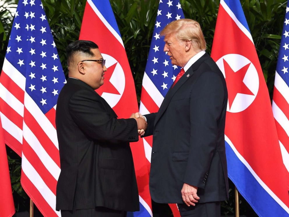 PHOTO: North Koreas leader Kim Jong Un shakes hands with President Donald Trump at the start of their historic summit, at the Capella Hotel on Sentosa island in Singapore on June 12, 2018.