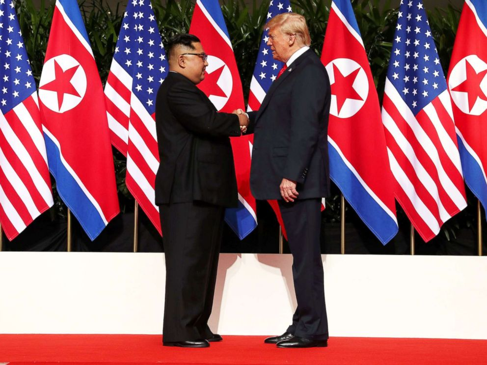 PHOTO: President Donald Trump shakes hands with North Korean leader Kim Jong Un at the Capella Hotel on Sentosa island in Singapore, June 12, 2018.