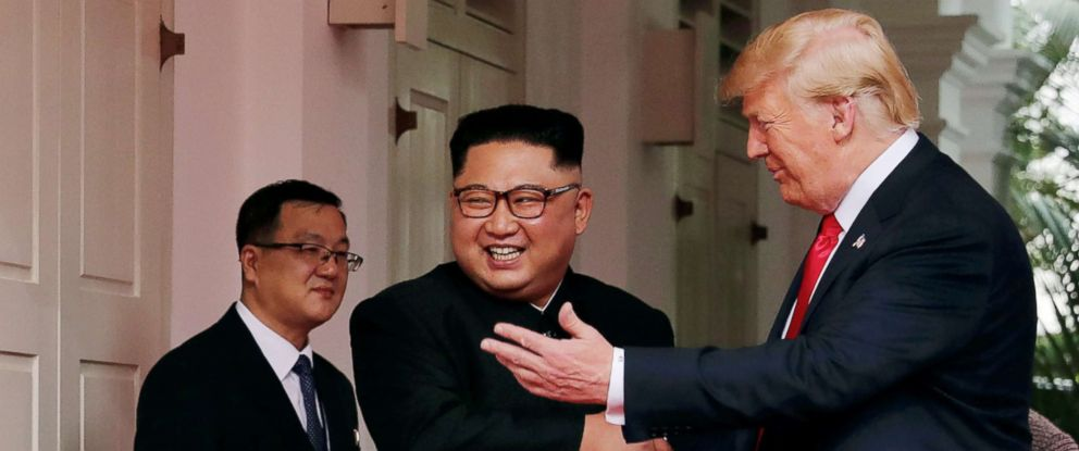 PHOTO: President Donald Trump shakes hands with North Koreas leader Kim Jong Un at the Capella Hotel on Sentosa island in Singapore on June 12, 2018.