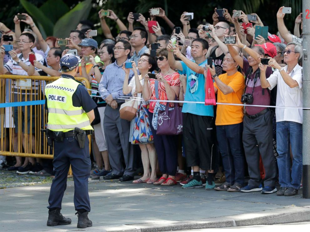 PHOTO: Singaporeans gather in front of the Istana Presidential Palace, where President Donald Trump and Singapore Prime Minister Lee Hsien Loong will meet in Singapore, June 11, 2018.  EXCLUSIVE: 'I do trust him': Trump opens up about Kim after historic summit trump kim summit 01 ss jc 180611 hpMain 4x3 992