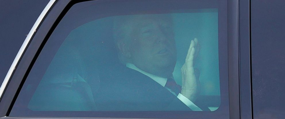 PHOTO: President Donald Trump waves from inside his car as he heads into the Istana Presidential Palace, where he will meet with Singapore Prime Minister Lee Hsien Loong, 11 June 2018.