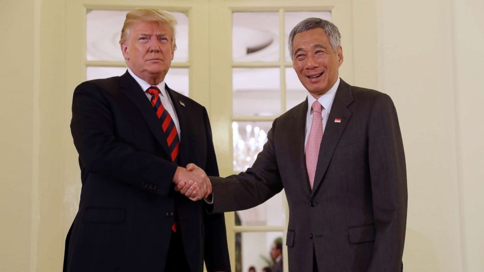President Donald Trump shakes hands with Singapore Prime Minister Lee Hsien Loong ahead of a summit with North Korean leader Kim Jong Un, June 11, 2018, in Singapore.