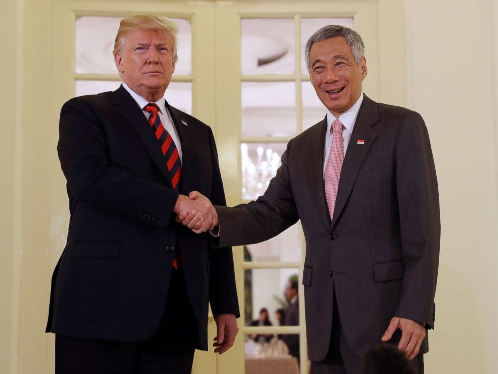 PHOTO: President Donald Trump shakes hands with Singapore Prime Minister Lee Hsien Loong ahead of a summit with North Korean leader Kim Jong Un, June 11, 2018, in Singapore.