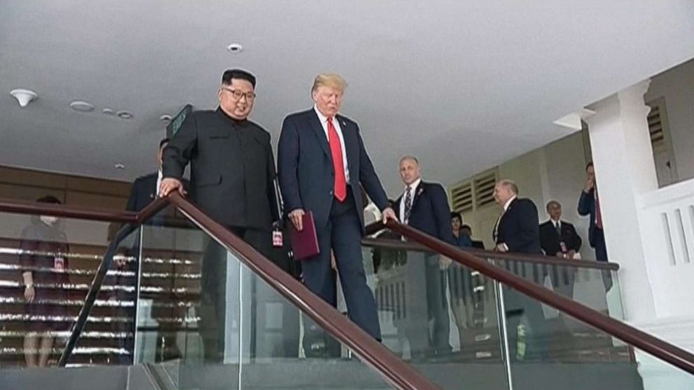 President Donald Trump and Kim Jong Un are pictured at their summit in Singapore in video shown on North Korean state television.