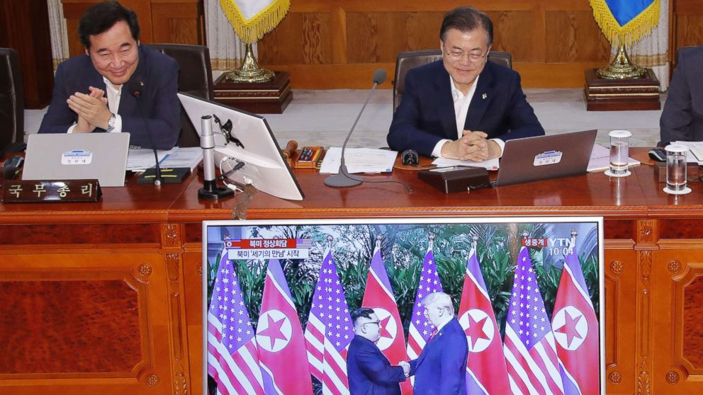 South Korean Prime Minister Lee Nak-yon and President Moon Jae-in watch a television screen showing the summit between President Donald Trump and North Korean leader Kim Jong Un during a Cabinet meeting at the presidential Blue House in Seoul on June 12, 2018.
