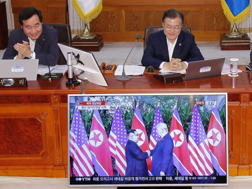 PHOTO: South Korean Prime Minister Lee Nak-yon and President Moon Jae-in watch a television screen showing the summit between President Donald Trump and North Korean leader Kim Jong Un during a Cabinet meeting in Seoul on June 12, 2018.