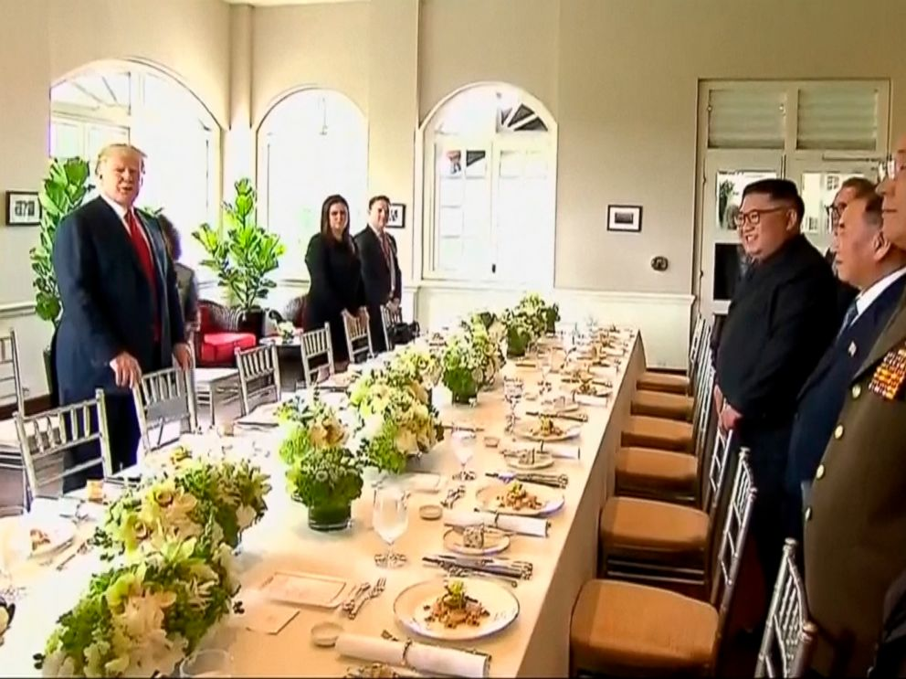 PHOTO: In this image made from video provided by Host Broadcaster Mediacorp Pte Ltd,, U.S. President Donald Trump and North Korean leader Kim Jong Un arrive for a working lunch at Capella Hotel in Singapore, June 12, 2018.