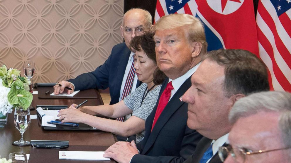 President Donald Trump and his translator and delegation sit down with North Korean leader Jim Jong Un and his delegation at the Capella Hotel on Sentosa island in Singapore on June 12, 2018.