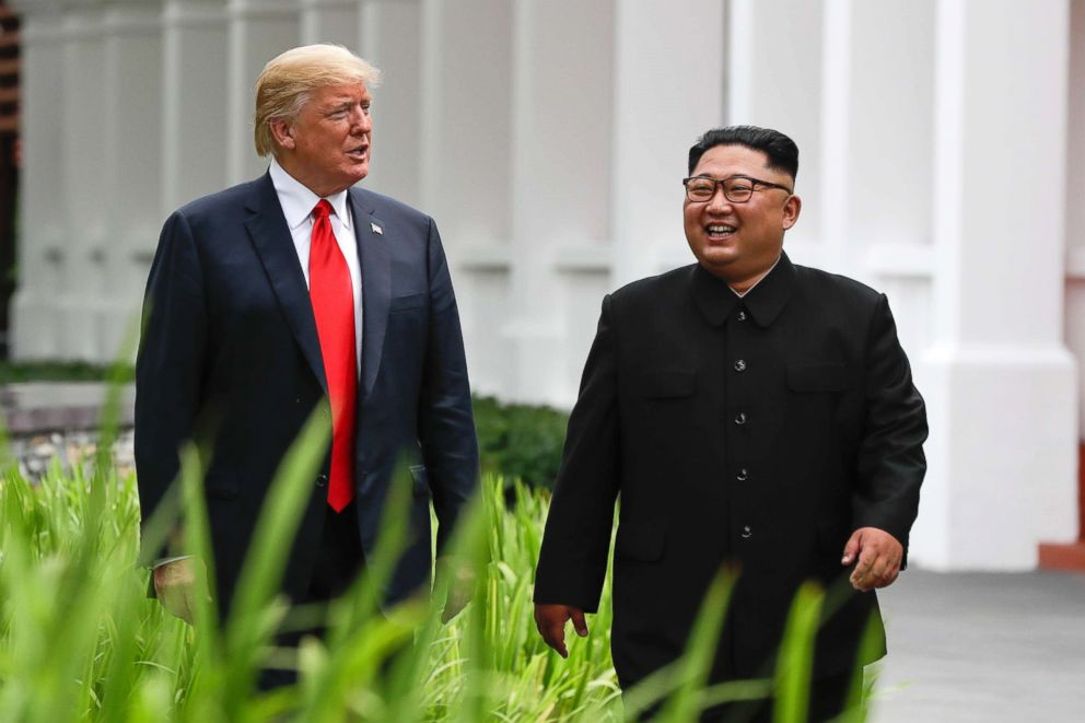 PHOTO: President Donald Trump and North Korea leader Kim Jong Un walk from their lunch at the Capella resort on Sentosa Island on June 12, 2018 in Singapore.