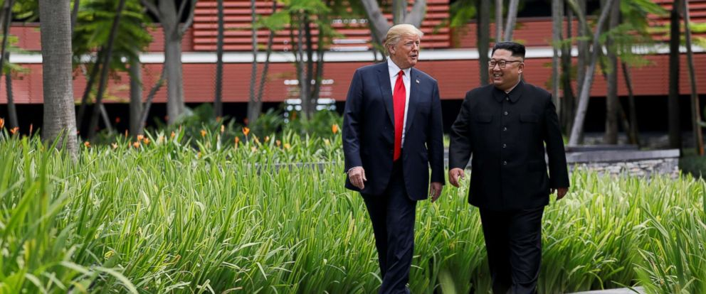 PHOTO: President Donald Trump and North Korean leader Kim Jong Un walk after lunch at the Capella Hotel on Sentosa island in Singapore, June 12, 2018.