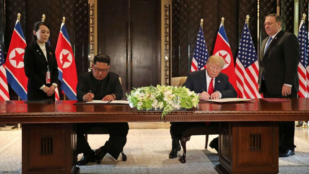 President Donald Trump and North Korea's leader Kim Jong Un sign documents that acknowledge the progress of the talks and pledge to keep momentum going, after their summit at the Capella Hotel on Sentosa island in Singapore June 12, 2018.
