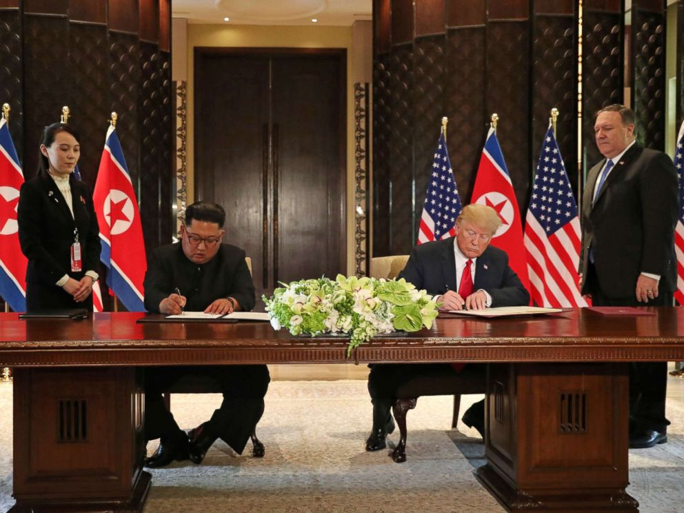 PHOTO: President Donald Trump and North Koreas leader Kim Jong Un sign documents that acknowledge the progress of the talks and pledge to keep momentum going, after their summit at the Capella Hotel on Sentosa island in Singapore June 12, 2018.