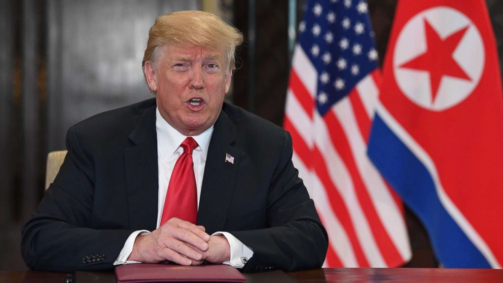 US President Donald Trump speaks at a signing ceremony with North Korea's leader Kim Jong Un during their historic summit, at the Capella Hotel on Sentosa island in Singapore on June 12, 2018.