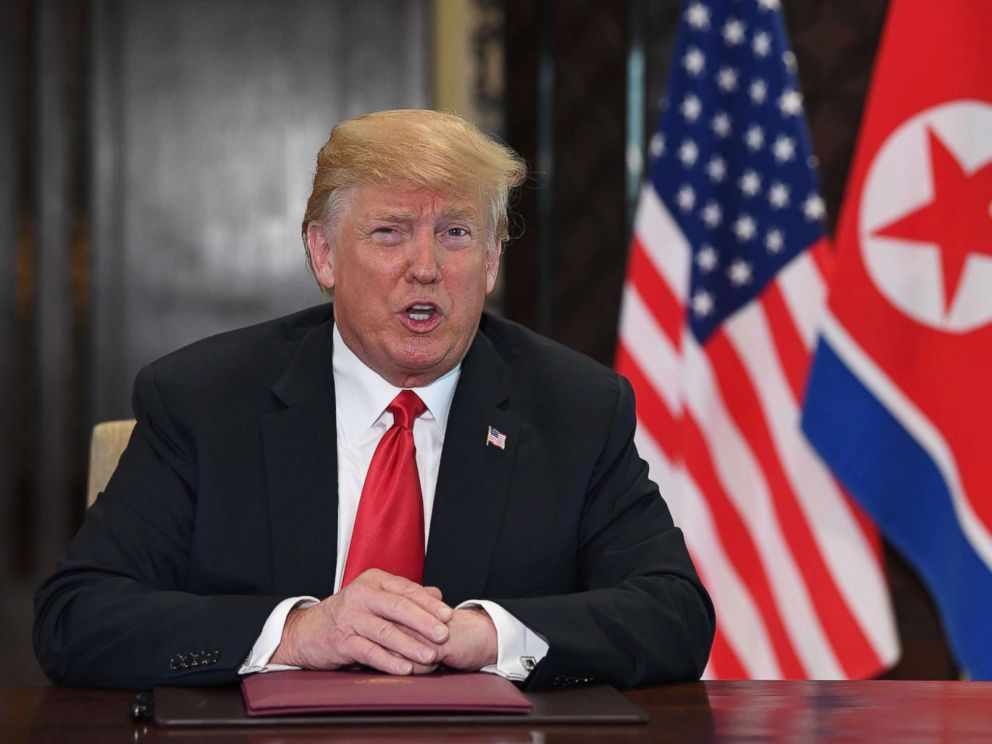 PHOTO: US President Donald Trump speaks at a signing ceremony with North Koreas leader Kim Jong Un during their historic summit, at the Capella Hotel on Sentosa island in Singapore on June 12, 2018.