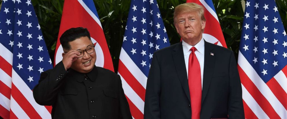 PHOTO: North Koreas leader Kim Jong Un smiles while posing with President Donald Trump after taking part in a signing ceremony at the end of their summit in Singapore, June 12, 2018.