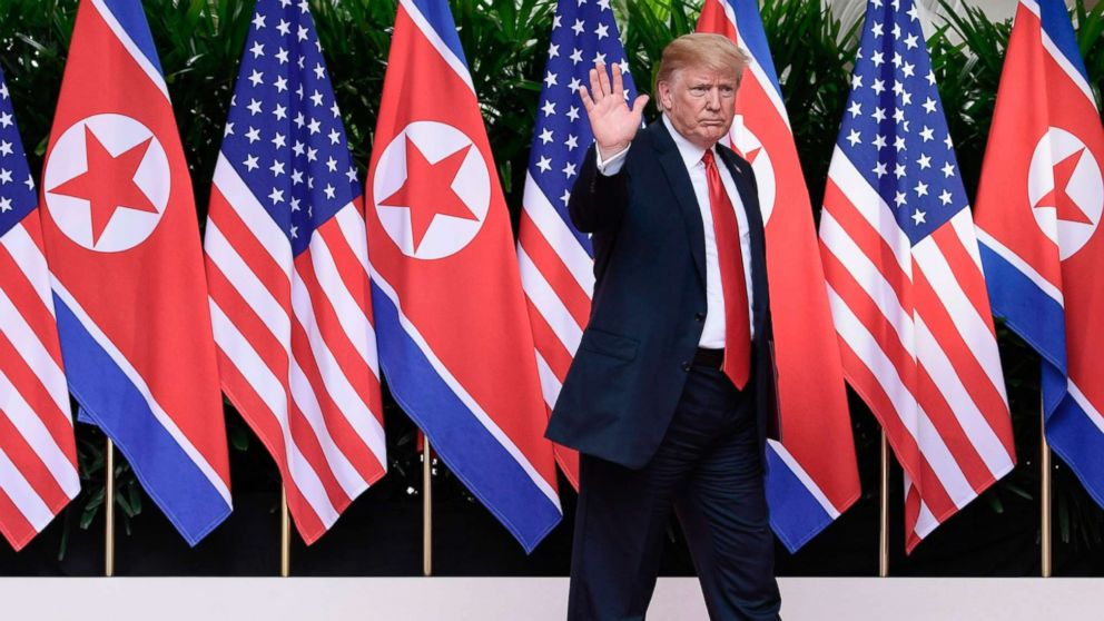 President Donald Trump waves after saying goodbye to North Korea leader Kim Jong Un at the Capella resort on Sentosa Island in Singapore on June 12, 2018.