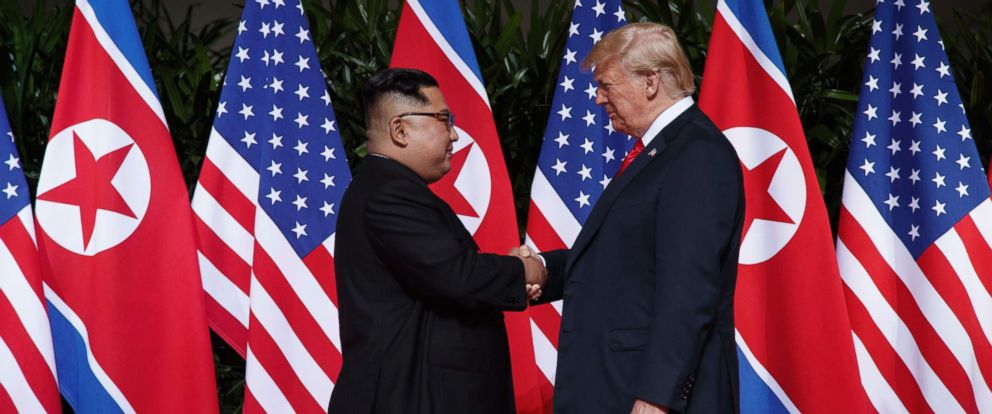 PHOTO: President Donald Trump shakes hands with North Korean leader Kim Jong Un on Sentosa Island, June 12, 2018, in Singapore.