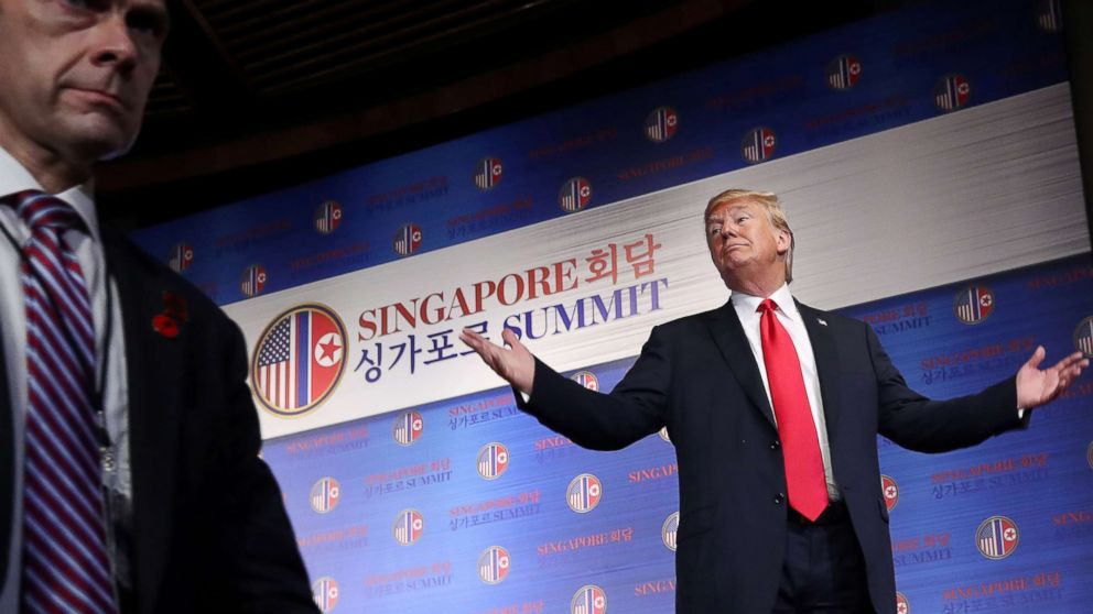 President Donald Trump gestures after a news conference following his meeting with North Korean leader Kim Jong Un at the Capella Hotel on Sentosa island in Singapore, June 12, 2018.