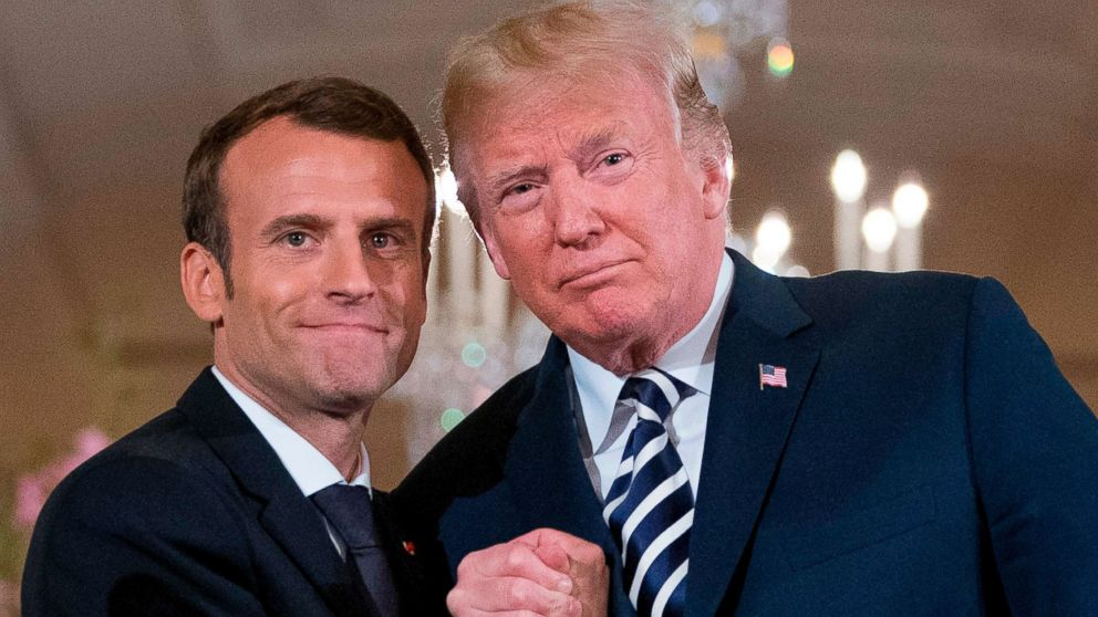 President Donald Trump and French President Emmanuel Macron embrace at the conclusion of a news conference in the East Room of the White House in Washington, April 24, 2018.