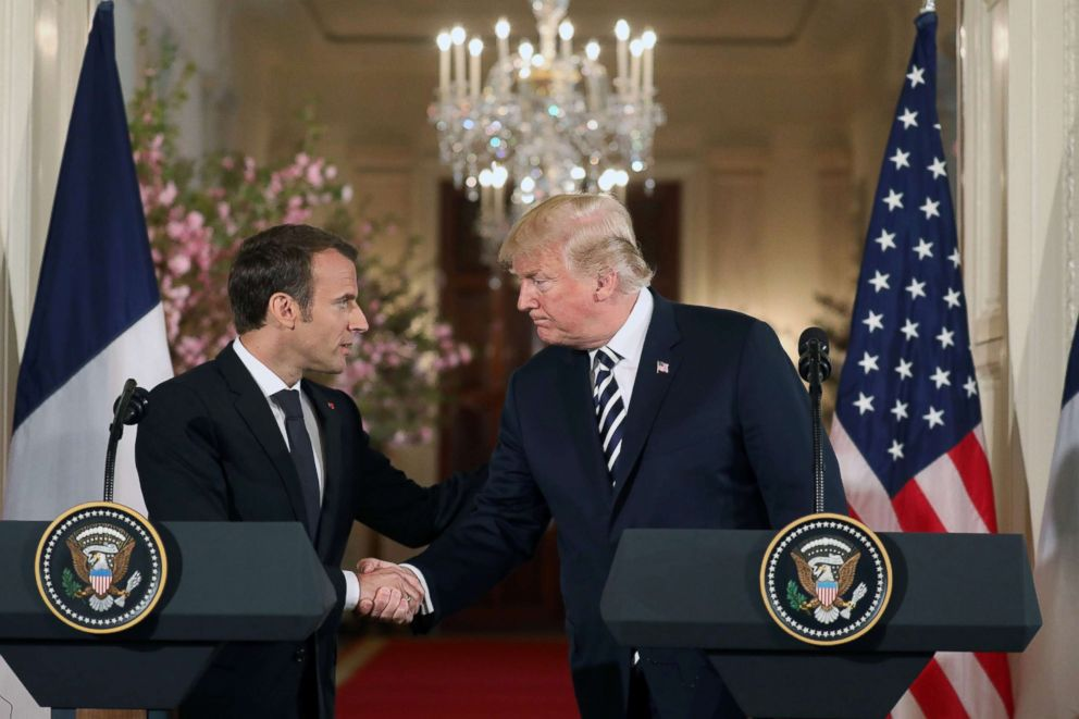 US President Donald Trump and French President Emmanuel Macron shake hands before holding a joint press conference at the White House in Washington, DC, on April 24, 2018.