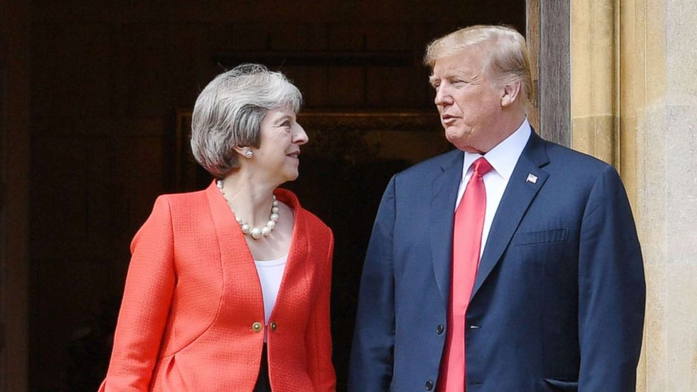 President Donald Trump and Britain's Prime Minister Theresa May stand together upon Trump's arrival for a meeting at Chequers, the prime minister's country residence, near Ellesborough, northwest of London, July 13, 2018.
