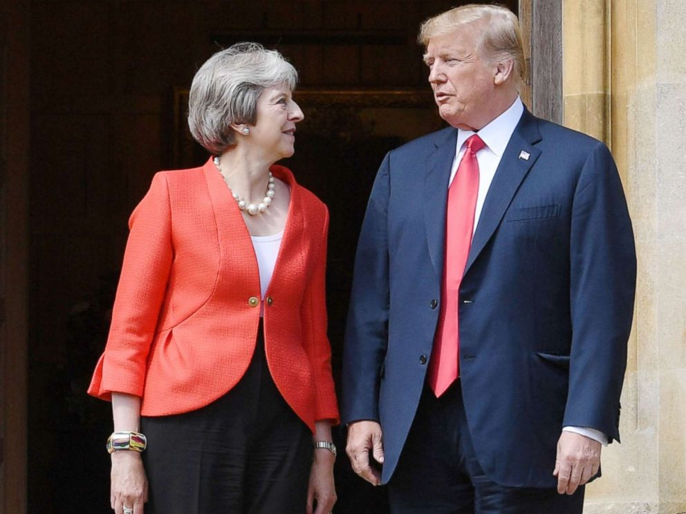 PHOTO: President Donald Trump and Britains Prime Minister Theresa May stand together upon Trumps arrival for a meeting at Chequers, the prime ministers country residence, near Ellesborough, northwest of London, July 13, 2018.