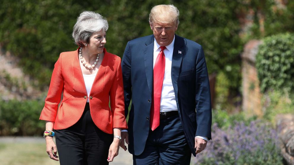 Prime Minister Theresa May walks with President Donald Trump at Chequers, July 13, 2018, in Aylesbury, England.