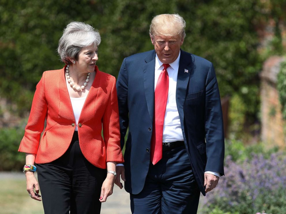 PHOTO: Prime Minister Theresa May walks with President Donald Trump at Chequers, July 13, 2018, in Aylesbury, England.