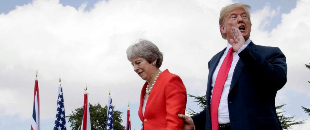 PHOTO: British Prime Minister Theresa May walks with President Donald Trump after their joint press conference at Chequers, in Buckinghamshire, England, July 13, 2018.