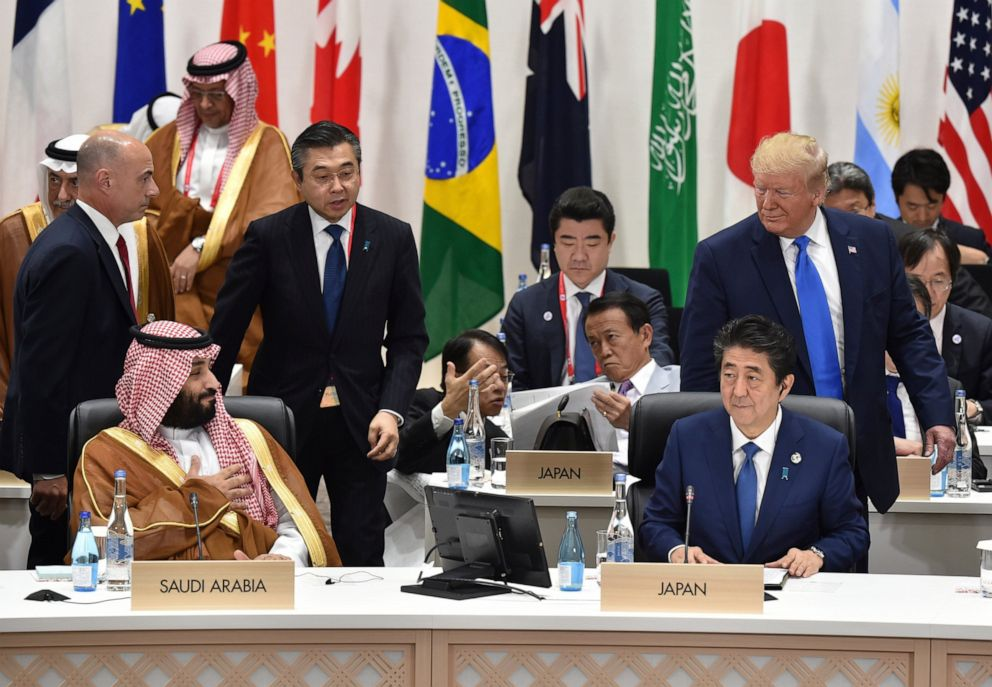 PHOTO: U.S. President Donald Trump, right, looks back at Saudi Arabias Crown Prince Mohammed bin Salman, left, as Japans Prime Minister Shinzo Abe, right bottom, looks on at the G-20 Summit in Osaka Saturday, June 29, 2019.