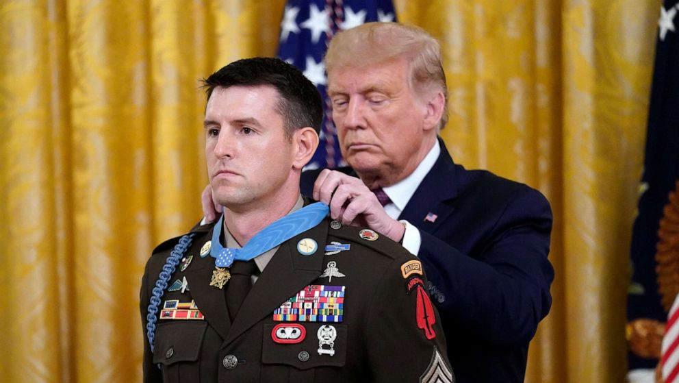 PHOTO: President Donald Trump gives the Medal of Honor to Army Sgt. Maj. Thomas P. Payne in the East Room of the White House on Sept. 11, 2020, in Washington.