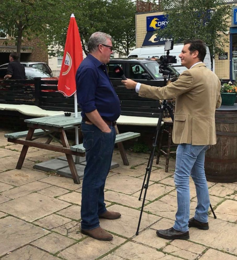 PHOTO: Damien Smyth, the pub landlord, is interviewed by Swiss television has attracted media attention from around the world.