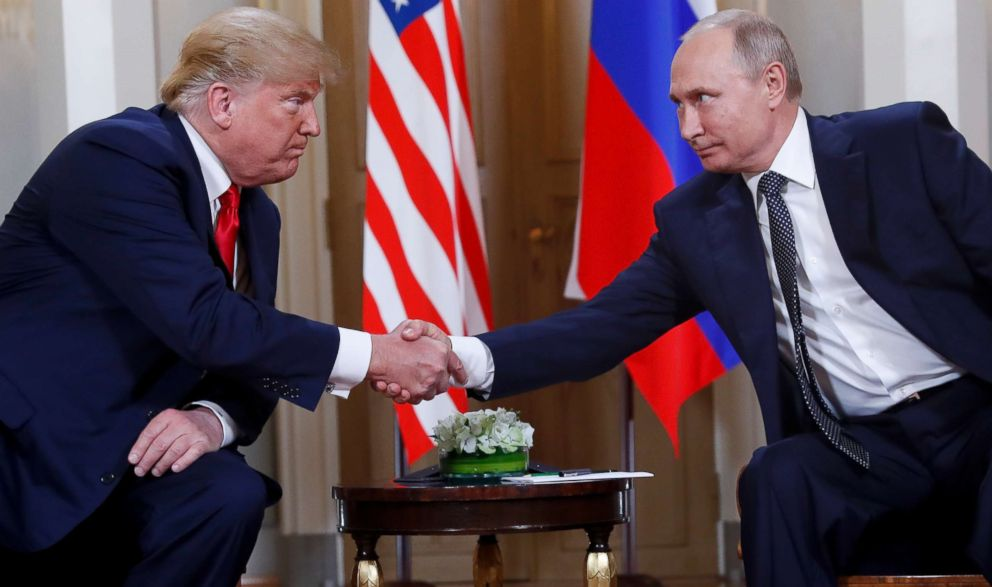PHOTO: In this July 16, 2018, file photo, U.S. President Donald Trump, left, and Russian President Vladimir Putin shake hands at the beginning of a meeting at the Presidential Palace in Helsinki, Finland.