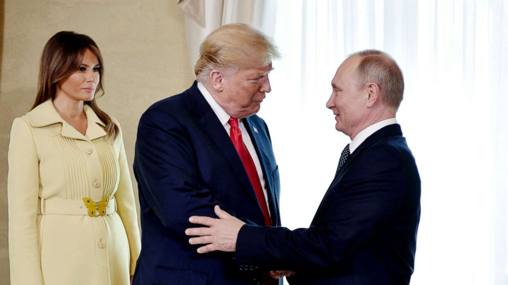 First lady Melania Trump, left, President Donald Trump and Russian President Vladimir Putin welcome each other at the Presidential Palace in Helsinki, Finland, July 16, 2018, prior to Trump's and Putin's one-on-one meeting in the Finnish capital.