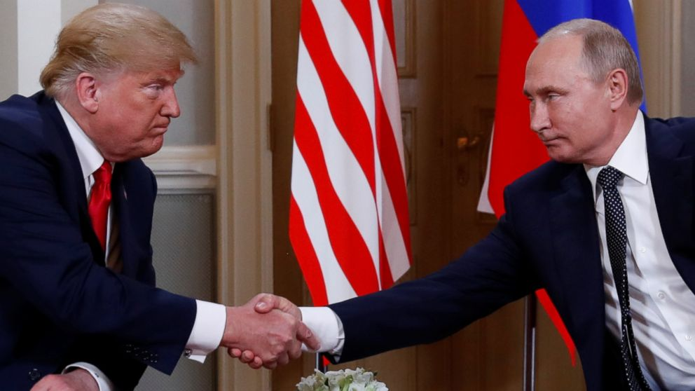 President Donald Trump and Russia's President Vladimir Putin shake hands as they meet in Helsinki, Finland, July 16, 2018.