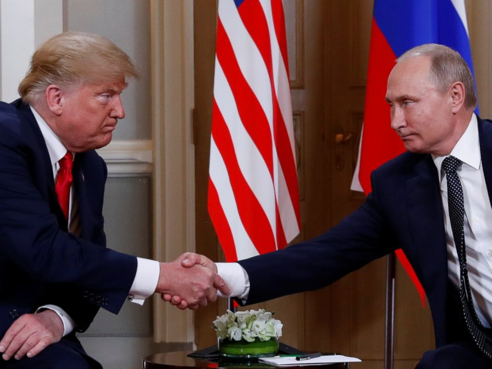 PHOTO: President Donald Trump and Russias President Vladimir Putin shake hands as they meet in Helsinki, Finland, July 16, 2018.