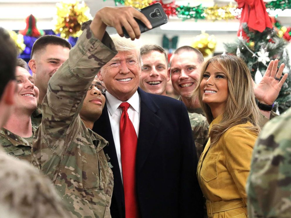 PHOTO: President Donald Trump and First Lady Melania Trump greet military personnel at the dining facility during an unannounced visit to Al Asad Air Base, Iraq, Dec. 26, 2018.