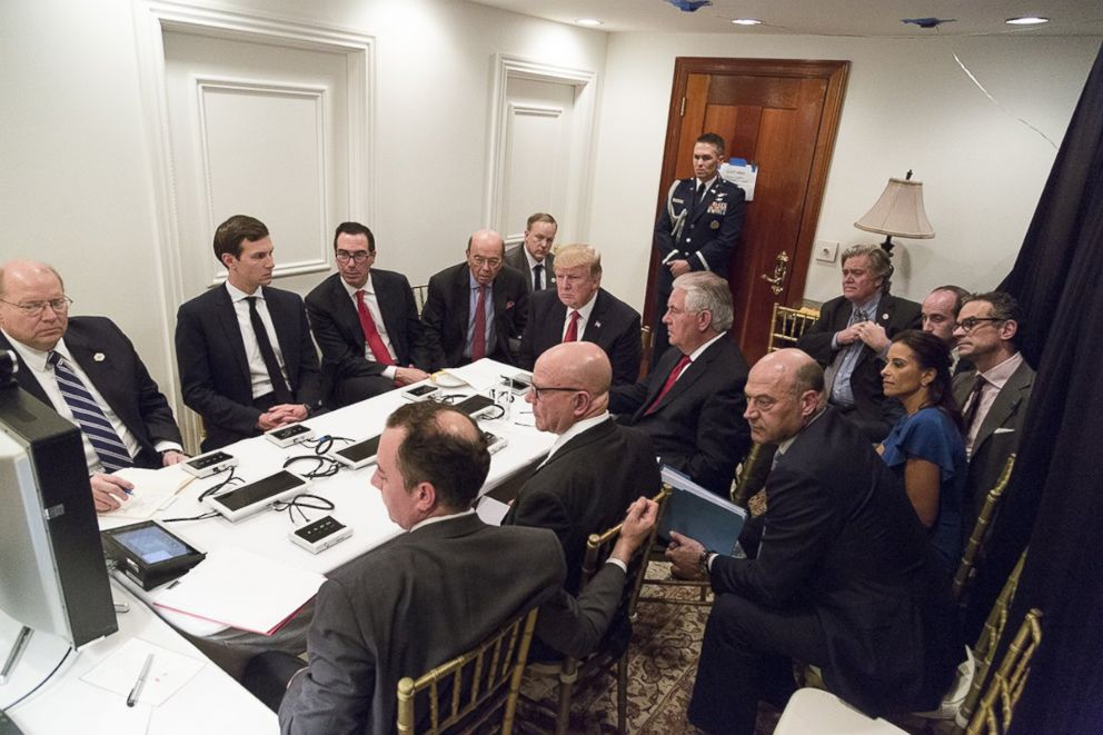 PHOTO: President Donald Trump receives a briefing, April 6, 2017, on a military strike on Syria from his National Security team.