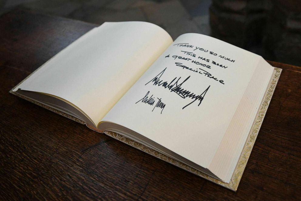 PHOTO: The visitors books signed by US President Donald Trump and his wife Melania after their tour of Westminster Abbey in central London, June 3, 2019.