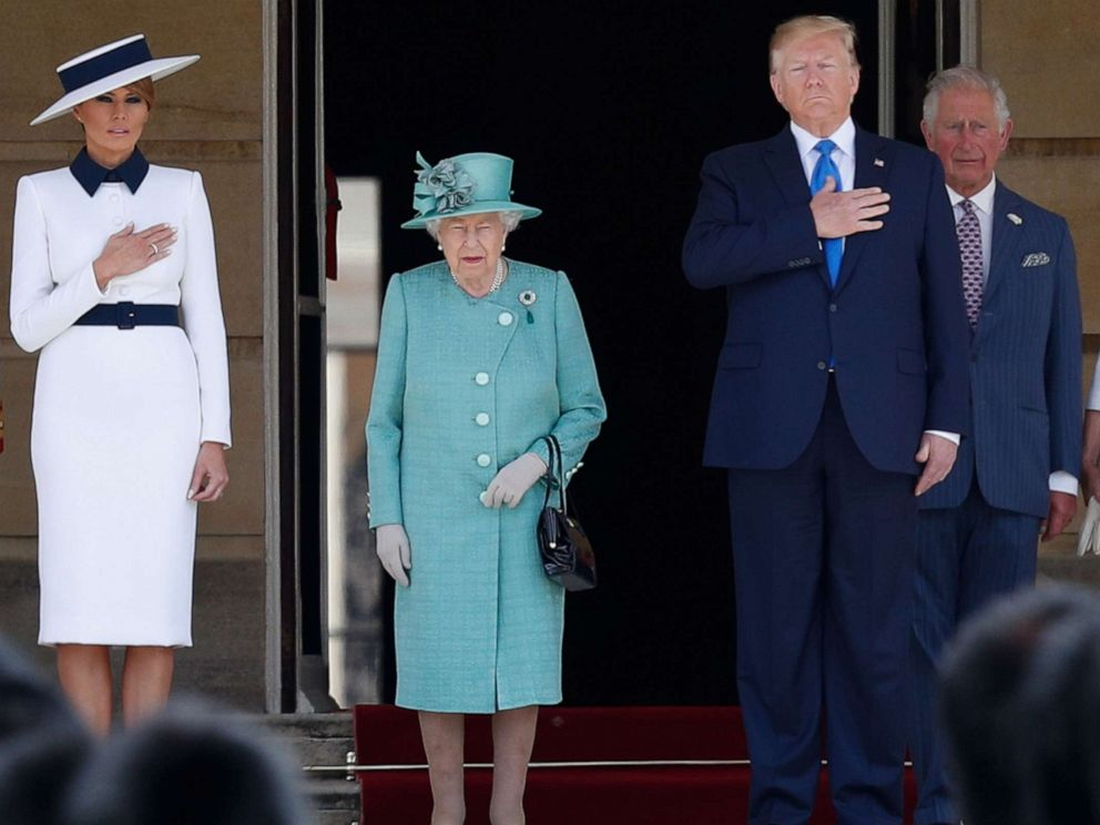 First lady Melania Trump, Britains Queen Elizabeth II, President Donald Trump, Britains Prince Charles, Prince of Wales and Britains Camilla, Duchess of Cornwall stand on the steps during a welcome ceremony at Buckingham Palace in London, June 3, 2019.