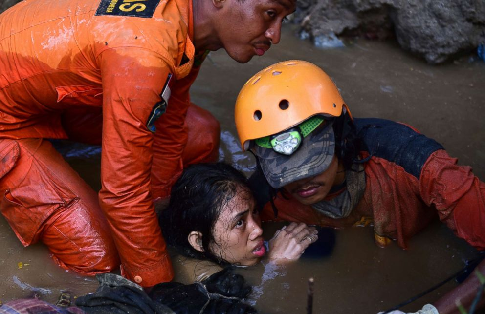 Rescuers try to rescue a 15-year old earthquake victim Nurul Istikharah from her damaged house following earthquakes and tsunami in Palu, Central Sulawesi, Indonesia, Sept. 30, 2018.