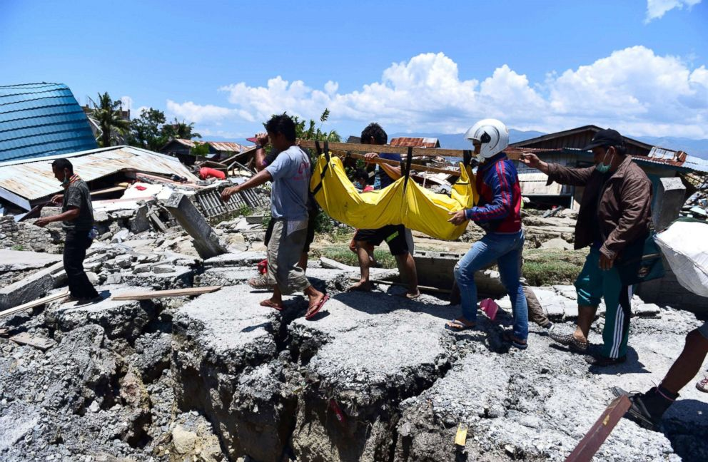 PHOTO: Villagers carry the body of a victim following earthquakes and tsunami in Palu, Central Sulawesi, Indonesia, Sept. 30, 2018.
