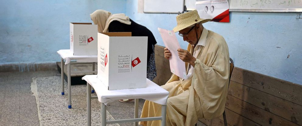 PHOTO: A man reads his ballot paper at a polling station during presidential election in Tunis, Tunisia, Sept. 15, 2019.