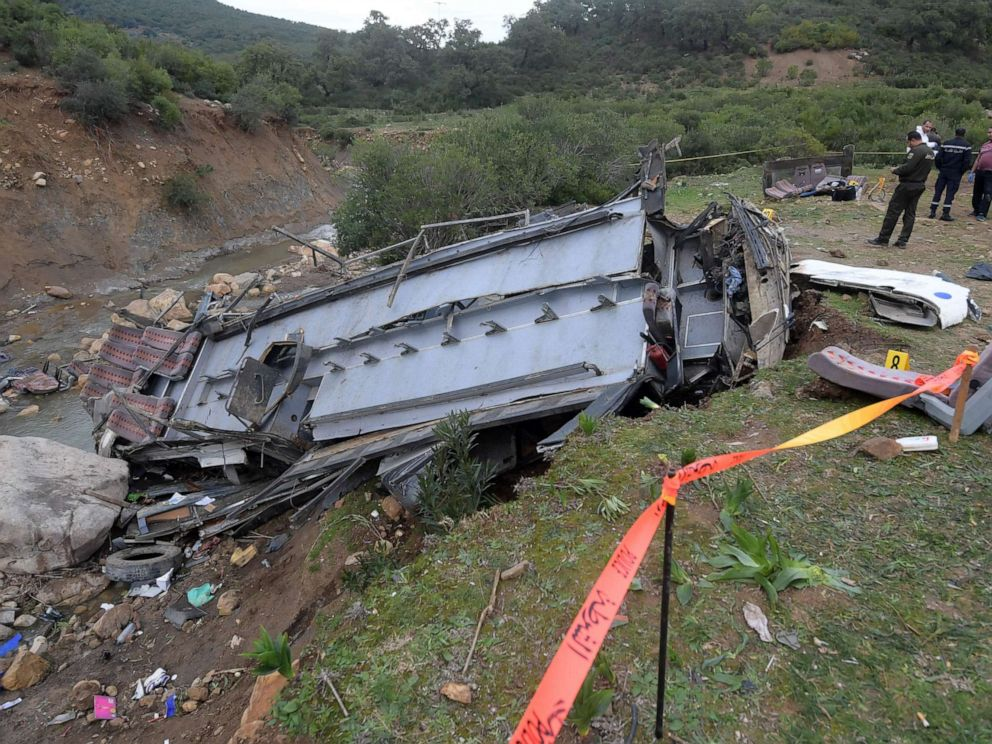 PHOTO: Tunisian authorities check the debris of a bus that plunged over a cliff into a ravine in Ain Snoussi in northern Tunisia on Dec. 1, 2019.